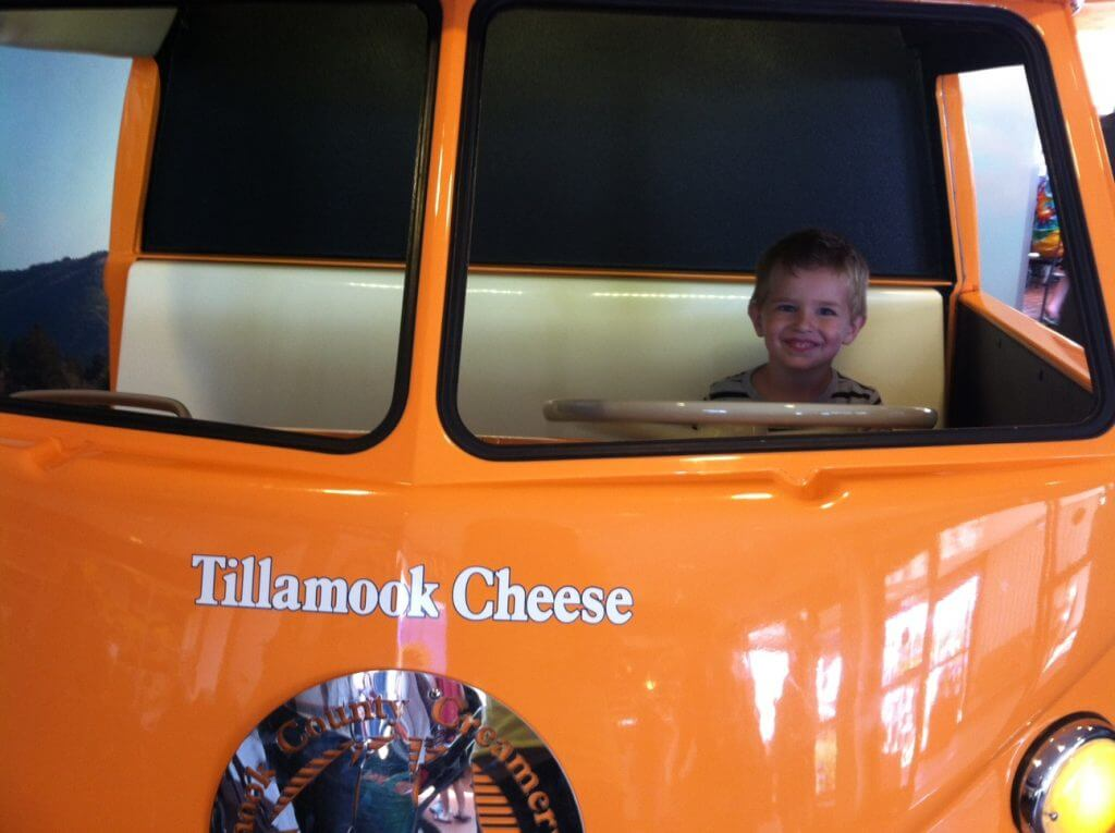 Photo of a boy at the Tillamook Cheese Factory on the Oregon Coast #tillamook #tillamookcheesefactory #oregoncoast #traveloregon