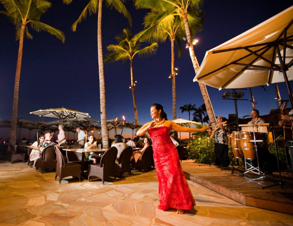 Photo of a woman dancing hula at a Waikiki restaurant, which is a cheap thing to do on Oahu #hula #waikiki #oahu #hawaii
