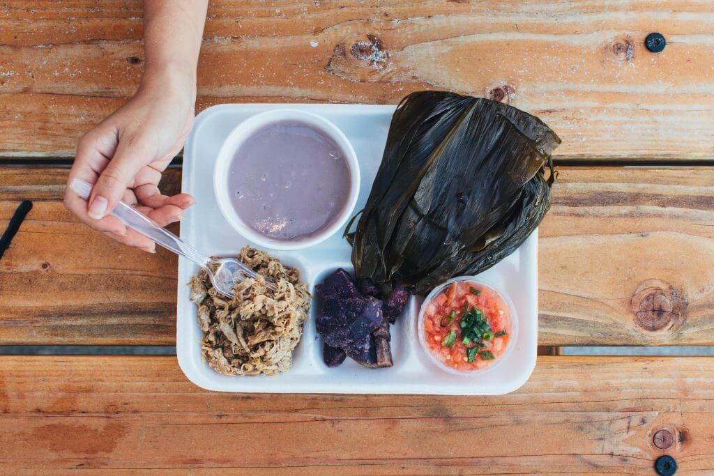 Wondering what food you will find at a Hawaiian luau? Enjoy poi, kalua pig, lau lau, lomi lomi salmon and more. #hawaiianfood #luau #platelunch