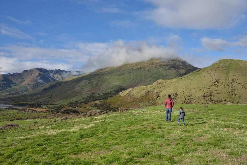 Photo of a mom and boy exploring Mt. Nicholas Farm in Queenstown, New Zealand, a fun thing to do in New Zealand with kids #newzealand #queenstown #farm #mtnicholas