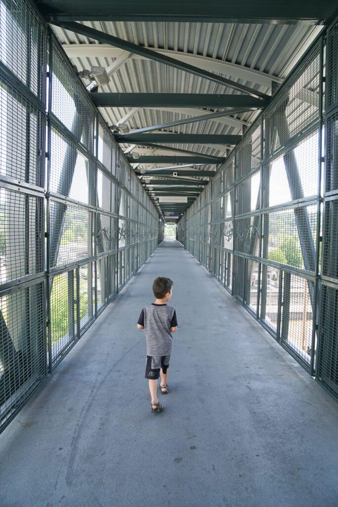Photo of a boy walking on the skybridge at Kent Station in Kent, Washington on the way to the Sounder train from Sound Transit #sounder #soundtransit #kentwa #visitkent #seattlewa