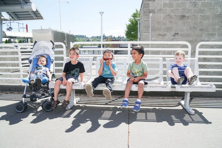 Photo of kids waiting for the Sounder train at Kent Station to King Street Station in Seattle, as part of a Seattle play date #sounder #soundtransit #kentwa #visitkent #train #seattle #seattlewa #seattleplaydate #seattlekids #seattlefamily