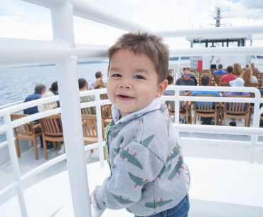 Photo of a toddler on the Argosy Cruises ship to Tillicum Village on Blake Island near Seattle, WA #argosycruises #blakeisland #tillicumvillage #seattle #seattlewa #pnw #pacificnorthwest #boat #seattlecruise