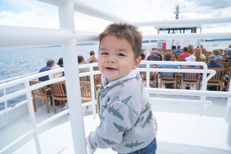 Photo of a toddler on the Argosy Cruises ship to Tillicum Village on Blake Island near Seattle, WA #argosycruises #blakeisland #tillicumvillage #seattle #seattlewa #pnw #pacificnorthwest #boat #seattlecruise