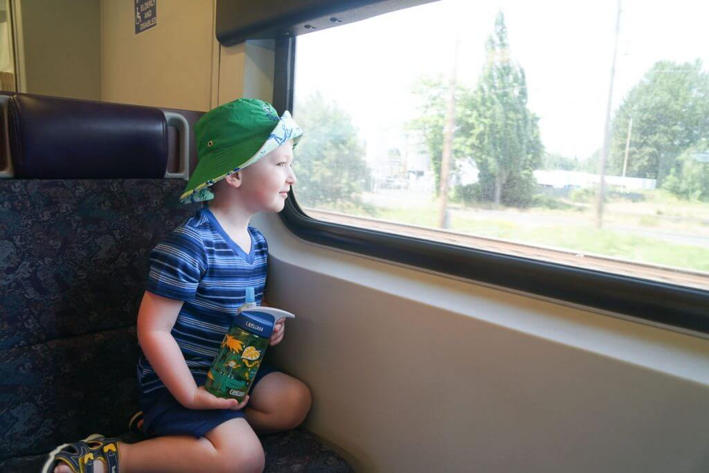 Photo of a kid on the Sounder train to Seattle, WA from Kent Station in Kent, WA #soundtransit #sounder #kentstation #boeingfield #tukilwa #seattlewa #visitseattle