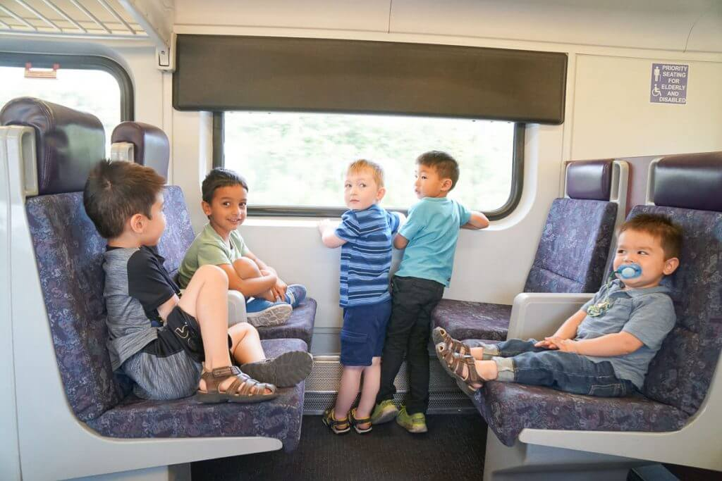 Photo of kids on the Sounder train from Kent, WA to Seattle, WA on a Seattle play date #sounder #soundtransit #kentstation #internationaldistrict #kingstreetstation #seattlewa #seattlechinatown