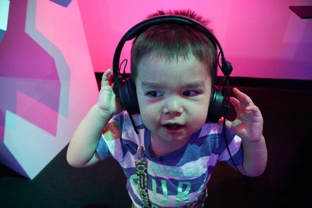 Photo of a toddler wearing headphones at the Sound Lab at Seattle Museum of Pop Culture, formerly the Experience Music Project #soundlab #mopop #mopopculture #headphones #toddlerlife #seattlewithkids