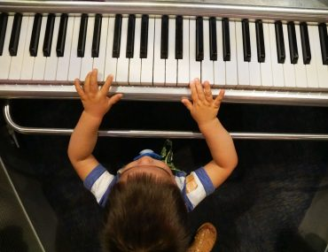 Photo of a toddler playing piano at the Sound Lab at the Seattle Museum of Pop Culture. #mopopculture #seattlecenter #music #soundlab #visitseattle