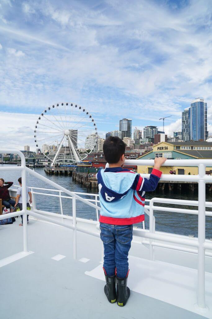 Photo of the Seattle Waterfront, including the Seattle Great Wheel, from the Seattle Argosy Cruise to Tillicum Village, a day trip from Seattle. #seattle #seattlewaterfront #seattlegreatwheel #argosycruises #seattlecruise #seattleboat