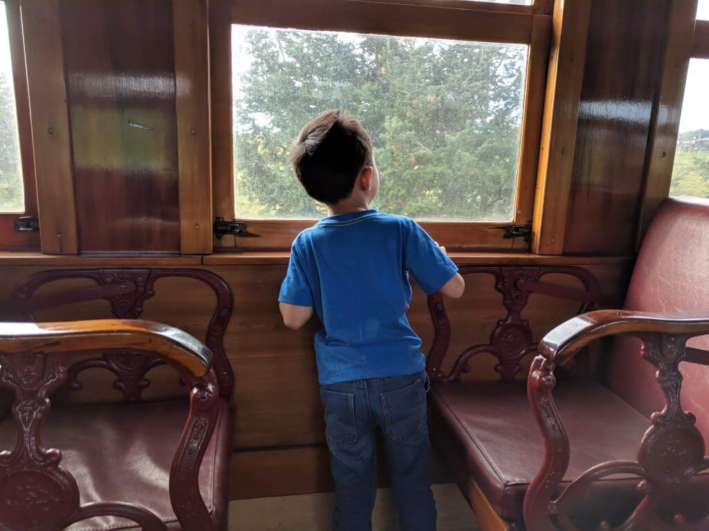 Photo of a boy riding a train at Glenbrook Vintage Railway in New Zealand. #newzealand #auckland #glenbrookvintagerailway #train