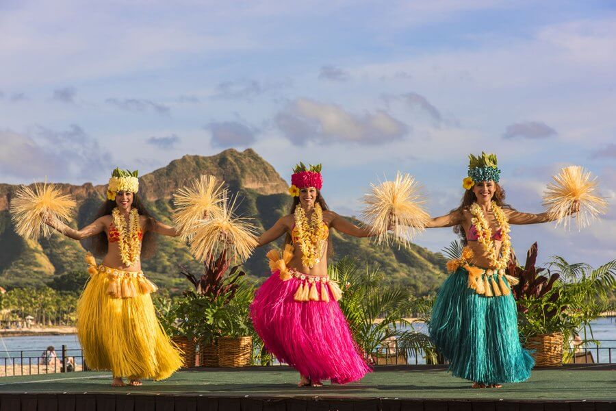Photo of Tahitian dancers at the Aha`Aina Luau in Waikiki on Oahu. It's one of the best Oahu luau in Waikiki. This Honolulu luau is a fun activity on Oahu. #luau #waikiki #royalhawaiianresort #waikikiluau #diamondhead #tahitiandancing #hawaiianluau #oahuluau