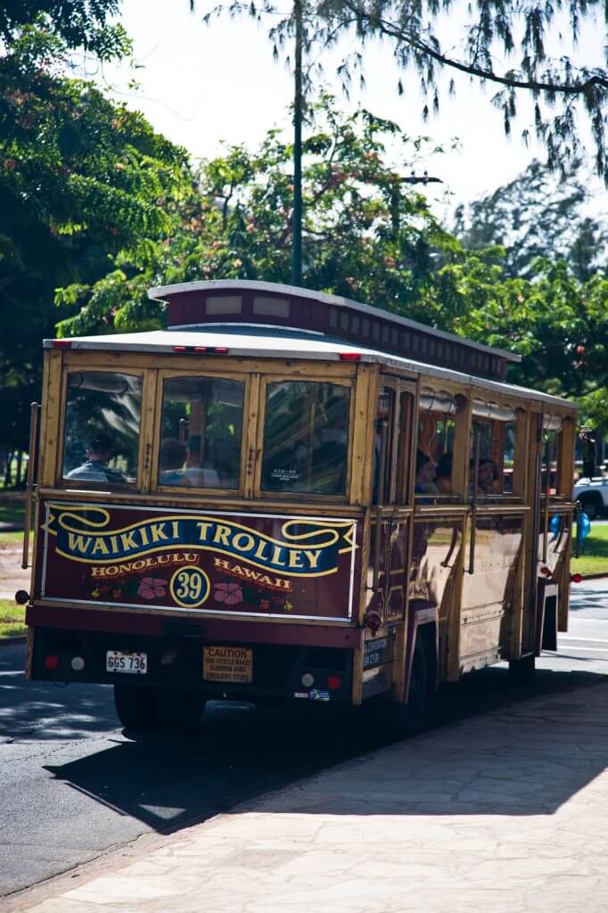 Photo of the Waikiki Trolley, which is a fun thing to do on Oahu and an easy way to get around Oahu. Find out more in my family guide to Oahu, Hawaii with Kids #waikiki #waikikitrolley #oahu #hawaii