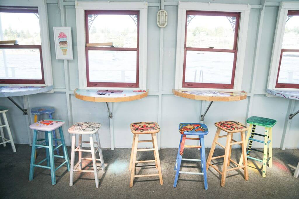 Photo of a board game area inside the Seattle Ice Cream Cruise on Lake Union in Seattle, WA. Riding a boat is a fun thing to do in Seattle with kids. #boardgames #boat #boatlife #seattleboat #seattlecruise #lakeunion #seattlewithkids #seattleattractions #seattleactivity #seattletourism