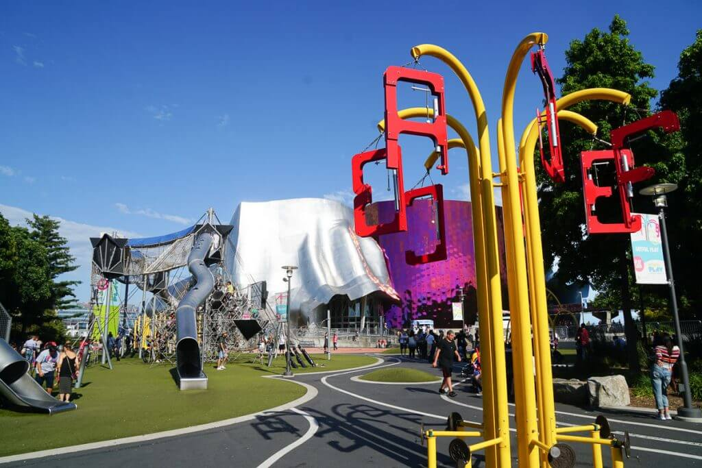 Photo of the Artists at Play playground at Seattle Center, near MoPOP, and is a kid-friendly Seattle attractions #mopop #artistsatplay #seattleplayground #seattlewithkids #seattlecenter #seattlepark