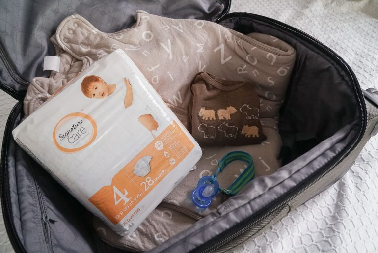 Memorable Family Travel Moments + Essentials for Traveling with a Baby #familytravel #flyingwithababy #flyingtips #travelwithababy #travelwithkids #diapers