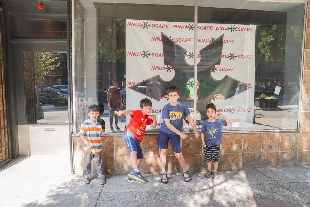 Photo of kids outside Ninja Escape, an escape room in Seattle, Washington that has kid-friendly escape rooms #escaperoom #seattleescaperoom #ninjaescape #seattlewithkids #belltown #fremont