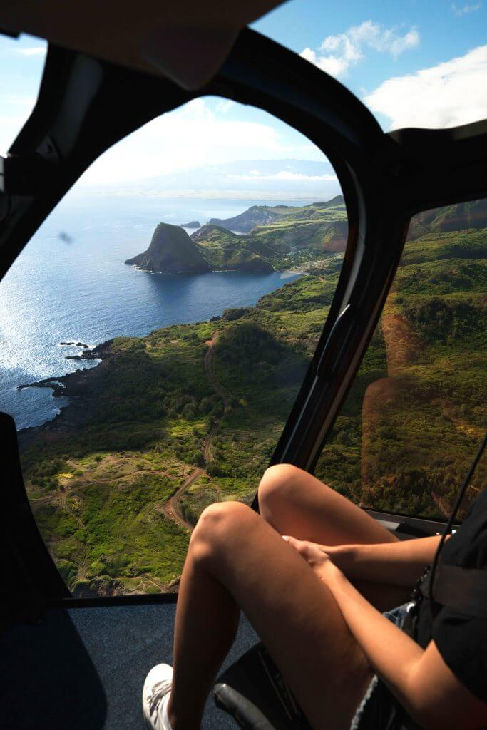 The Best Warm Places to Visit in December in the USA featured by top US travel blogger, Marcie in Mommyland: Photo of a helicopter ride from Maui to Molokai #helicopter #hawaii #maui #molokai
