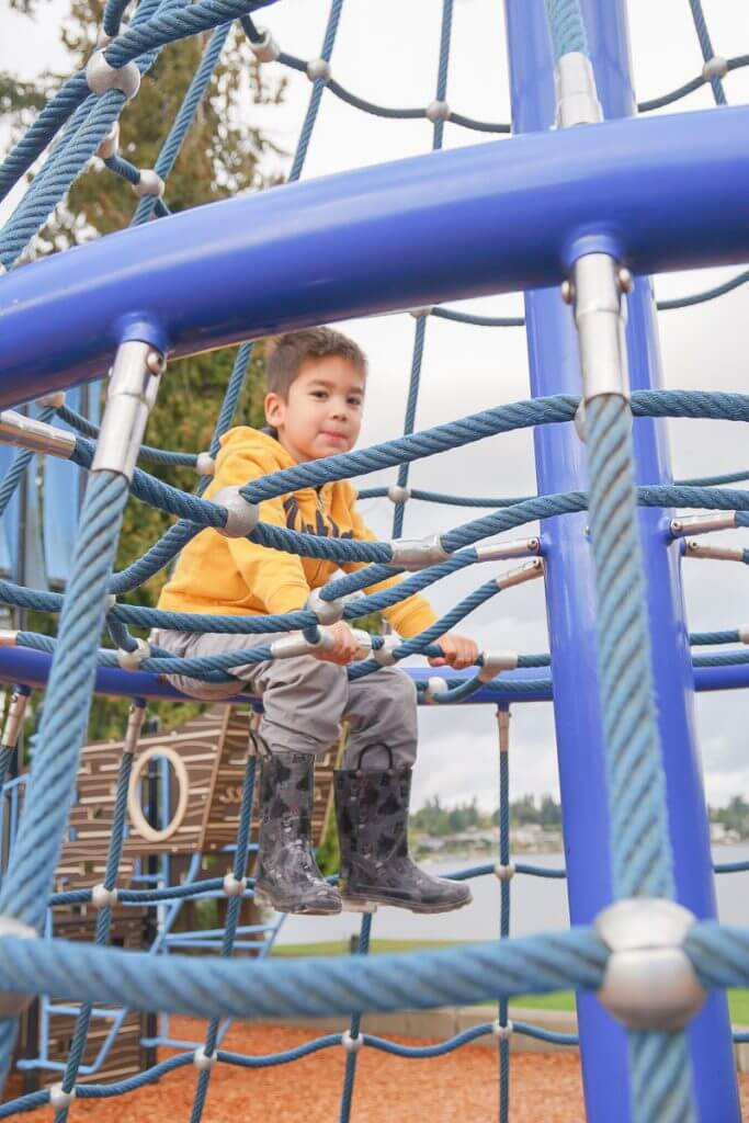 Photo of a PNW playground at Lake Meridian Park in Kent, WA, a kid-friendly staycation near Seattle #lakemeridian #lakemeridianpark #visitkentwa #playground
