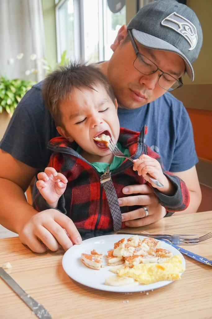 Photo of a toddler eating breakfast at Saimin Says in Kent, WA #visitkentwa #saiminsays