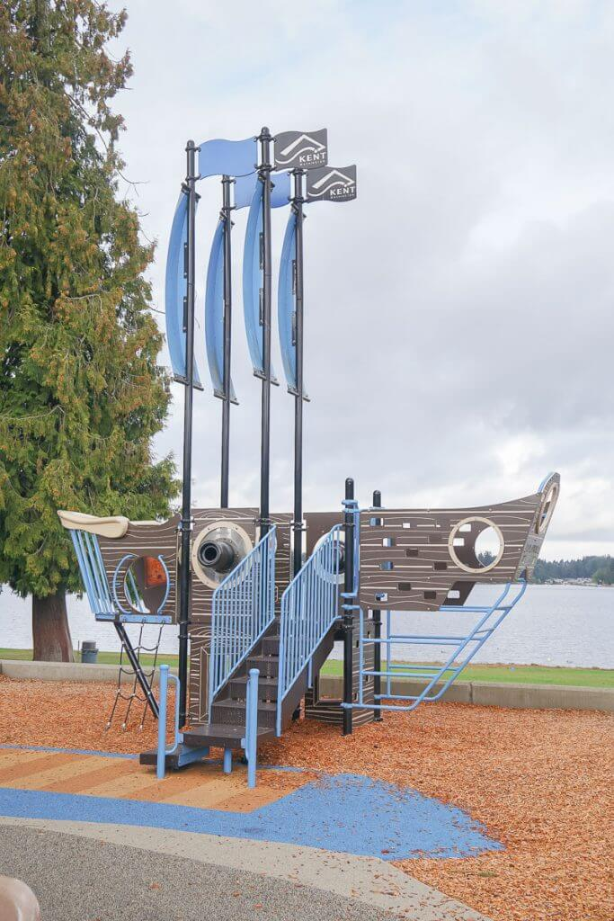 Photo of a pirate ship playground feature at Lake Meridian Park in Kent, WA #visitkentwa #lakemeridianpark #playground
