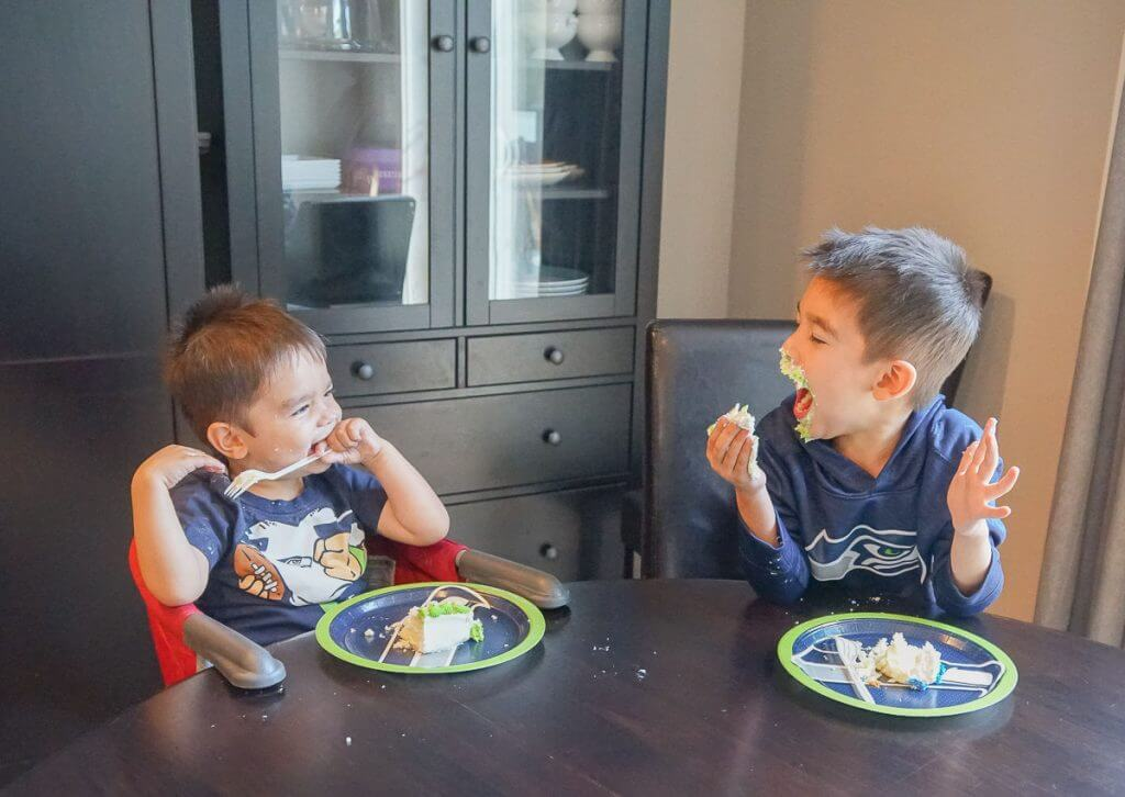 Photo of kids eating a Seattle Seahawks cake at a football party #seattleseahawks #seahawks #footballparty #footballcake #nflcake #decopac