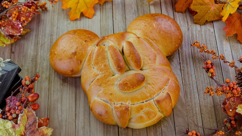 Photo of Mickey Bread with Fangs available at the Pacific Wharf Cafe at Disney California Adventure Park at Disneyland Resort this Halloween Season. #disneyland #halloween #mickey #mickeymouse #disneyfood #disneyeats