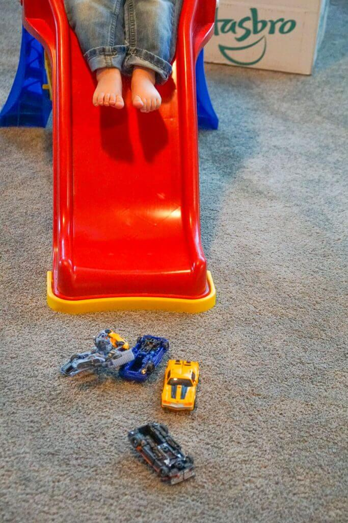 Photo of a boy playing with Transformers and his slide #transformers #bumblebeemovie #fredmeyerstores