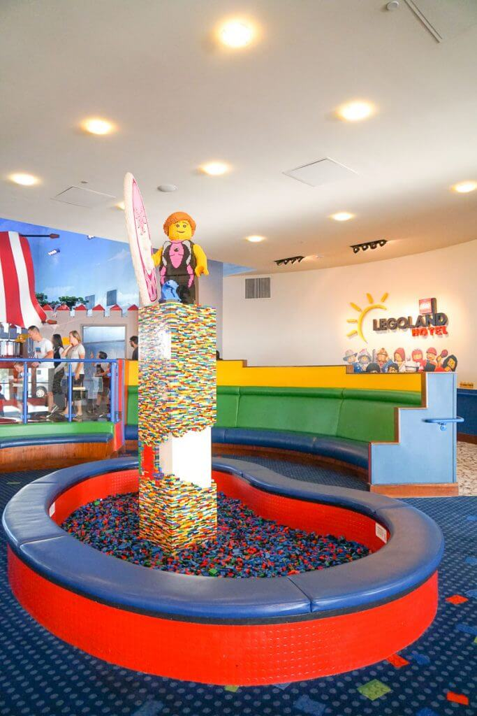 Photo of the LEGOLAND Hotel lobby with a huge LEGO play area. #legoland #legolandhotel #sandiego #carlsbad