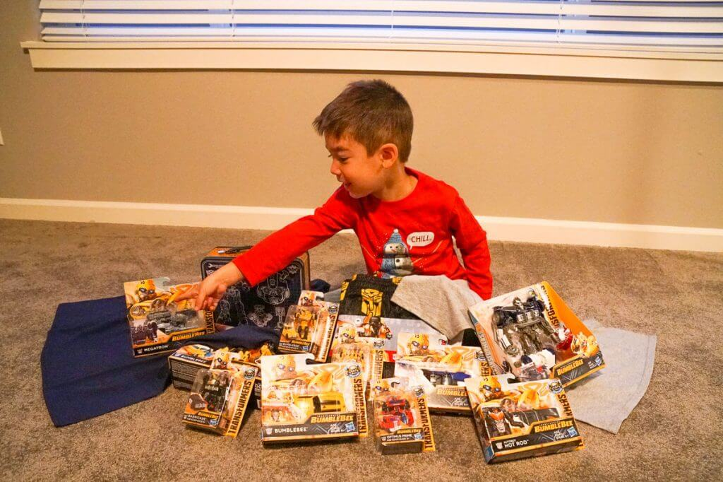 Photo of a boy and lots of Hasbro Transformers toys to celebrate the new Bumblebee movie #transformers #bumblebeemovie #hasbro #fredmeyerstores