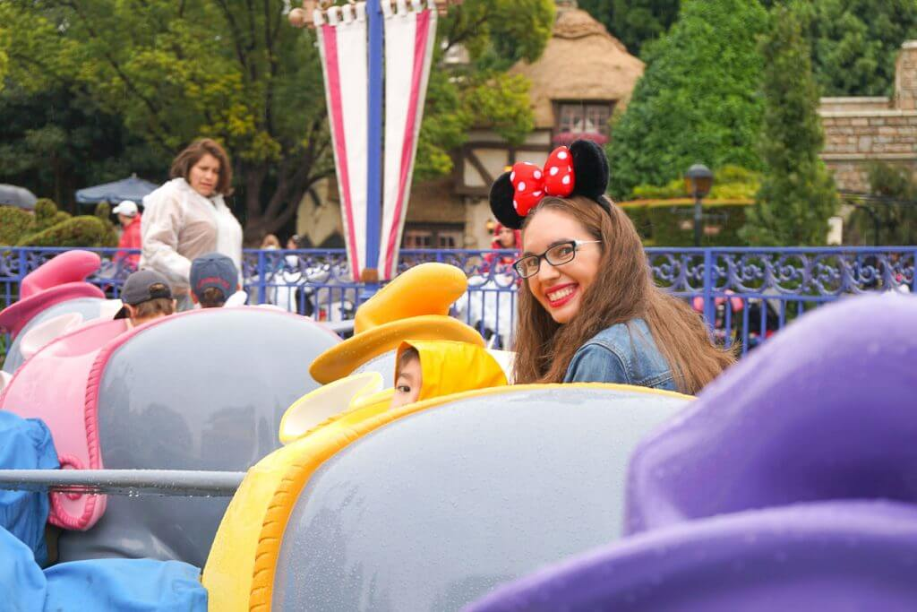 Photo of a Mom and boy riding Dumbo at Disneyland in the rain #DLP #Disneyland #Dumbo