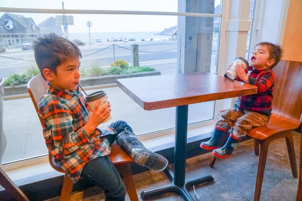 Photo of kids drinking apple cider at Stimulus Coffee + Bakery in Pacific City, Oregon #pacificcity #oregon #oregoncoast #familytravel