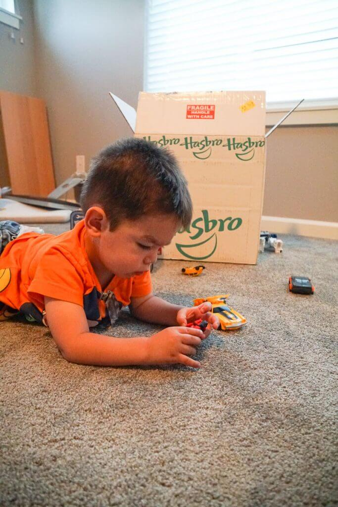 Photo of a toddler playing with Transformers from Hasbro #transformers #bumblebeemovie #hasbro