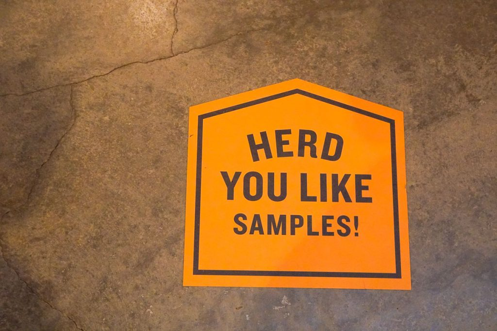 Photo of a sign at the Tillamook Creamery that reads: Herd You Like Samples! #TillamookCreamery #Tillamook #oregon #oregoncoast #pnw