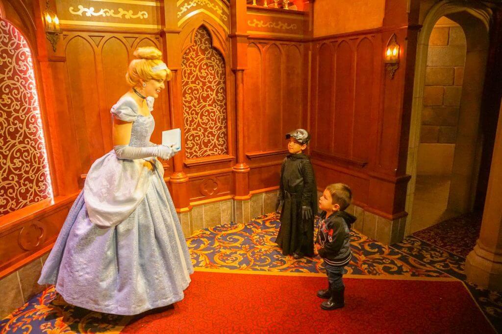 Photo of boys meeting Cinderella at the Royal Hall, a great place to beat the rain at Disneyland #cinderella #disneyland #DLR