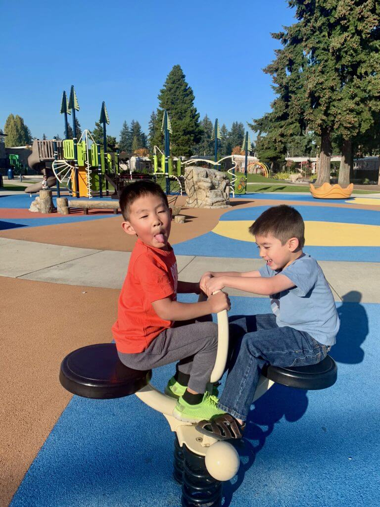 Photo of boys playing at an inclusive playground #rentonwa #pacificnorthwest #playground