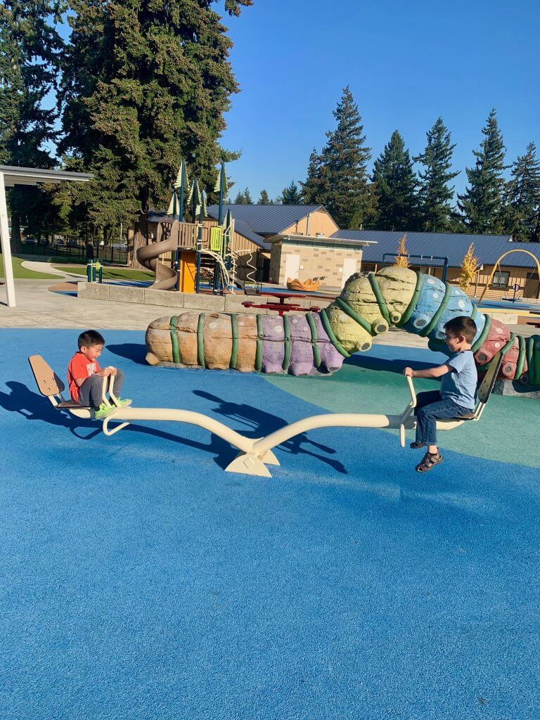 Photo of boys on a see saw at Meadow Crest Park in Renton, WA #seesaw #teetertotter #playground