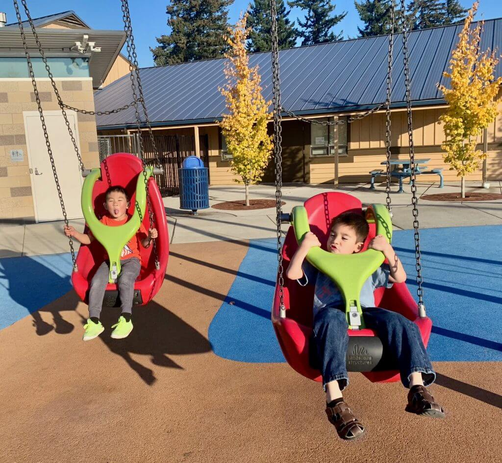 Photo of the swings at an inclusive playground in Washington State. #inclusiveplayground #seattle #rentonwa