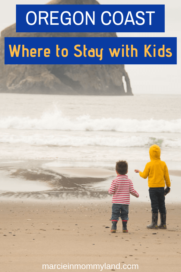 Wondering where to stay on the Oregon Coast with kids? The Inn at Cape Kiwanda is right across from the famous Haystack Rock in the Pacific Ocean! Click to read more or pin to save for later. www.marcieinmommyland.com #oregoncoast #roadtrip #oregon #pnw #familytravel