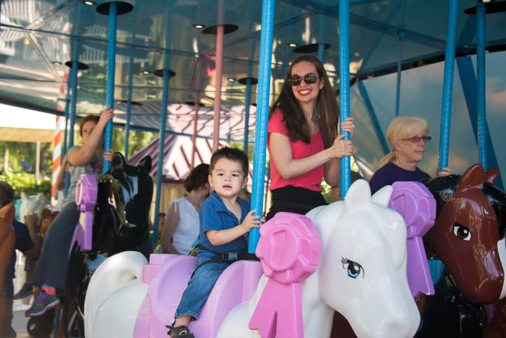 Photo of Mia's Riding Camp, a carousel at LEGOLAND California that's easy for toddlers #LEGOLANDCA #carousel #LEGOFriends