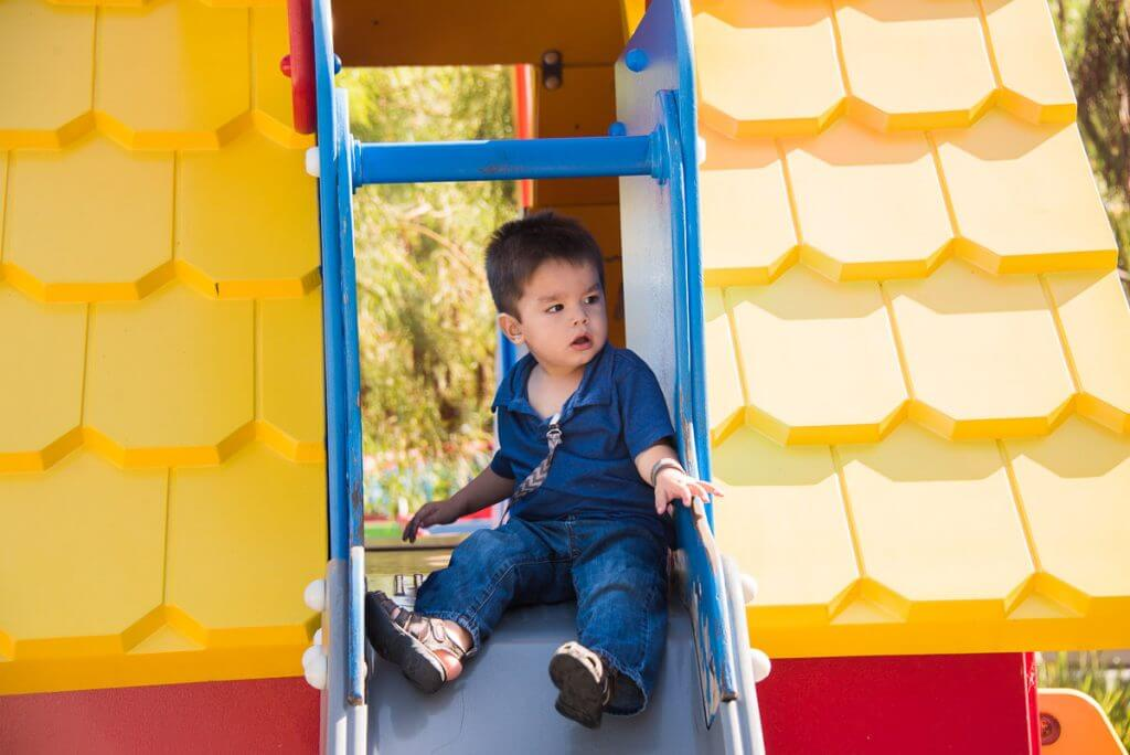 Photo of a toddler playing at DUPLO Playtown at LEGOLAND California, which is fun at LEGOLAND for toddlers #LEGOLANDCA #DUPLO #playground