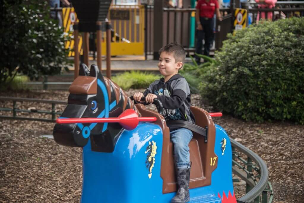 Photo of a 4 year old on a ride at LEGOLAND California #legolandca #sandiego