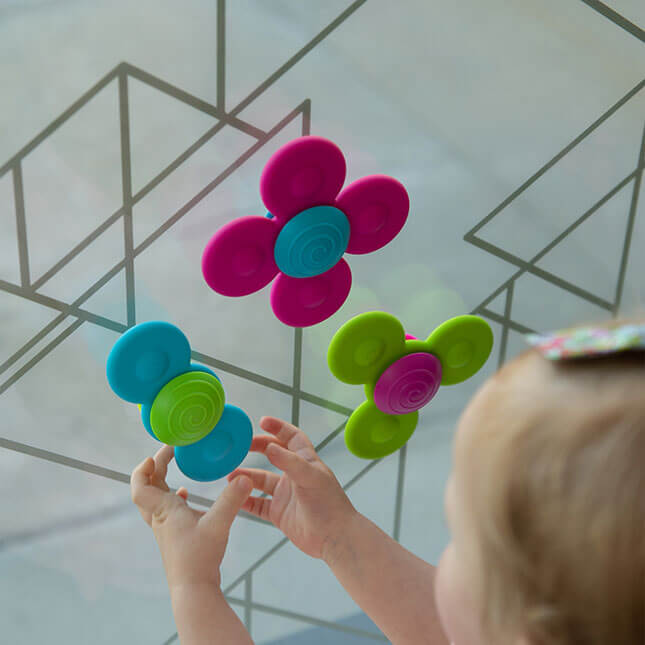 Whirly Squigz is a great travel toy for babies and toddlers. #fatbraintoys #babytoy #toddlertoy | The Perfect Travel Gift Ideas for the Family Who Travels featured by top Seattle family travel blog, Marcie in Mommyland: whirly squigz