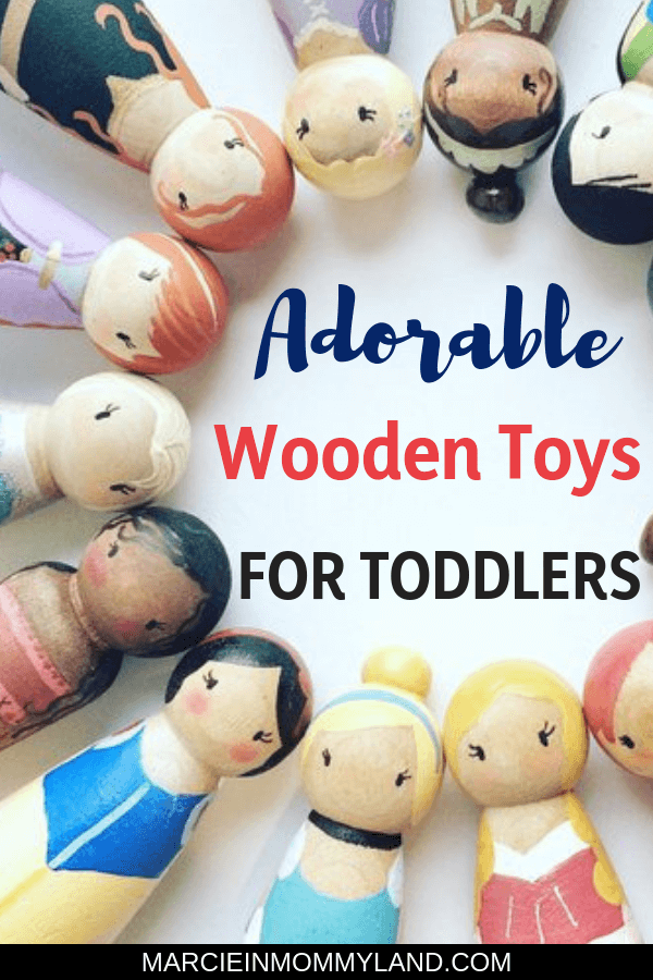 Looking for adorable wooden toys for toddlers that will stand the test of time? Get my top picks for toddler toys for boys and girls that are quiet, promote creativity and imagination. These are battery-free and some are handmade wooden toys! Click to read more or pin to save for later. www.marcieinmommyland.com #toddlertoys #woodentoys #toys #toddlers