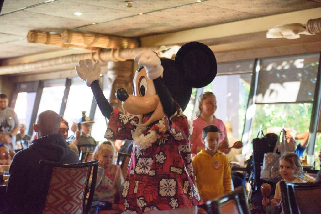 Photo of Mickey Mouse leading the parade at the Ohana character breakfast at Disney's Polynesian Village Resort #mickeymouse #ohana #ohanacharacterbreakfast #characterdining