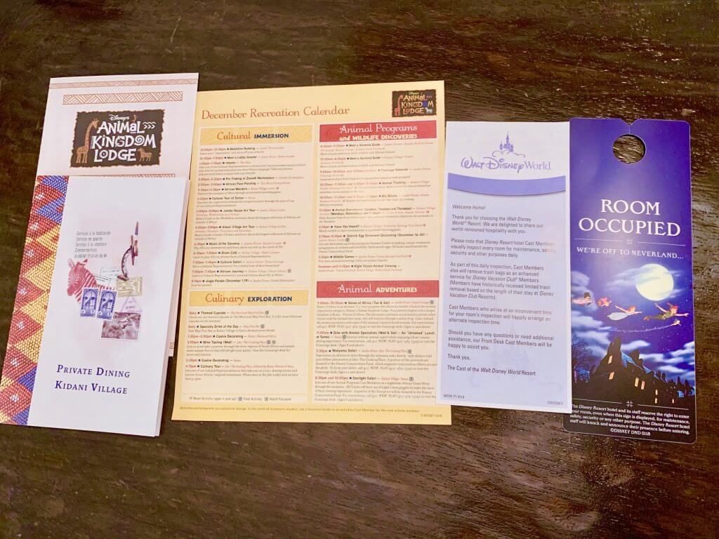 The Ultimate Review of Kidani Village at Walt Disney World featured by top US Disney blogger, Marcie and the Mouse: Photo of the brochures for Kidani Village at Disney's Animal Kingdom Lodge at Walt Disney World #animalkingdome #kidanivillage #waltdisneyworld #disneyworld