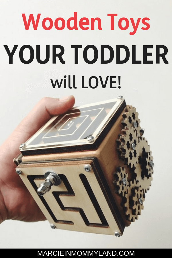 Are you tired of toys that make loud sounds? Find out the best wooden toys for toddlers and preschoolers that are battery-free and often handmade. These toys will keep kids busy for hours plus they will last for the next generation! Click to read more or pin to save for later. www.marcieinmommyland.com #woodentoys #toddler #toddlertoys #giftguide