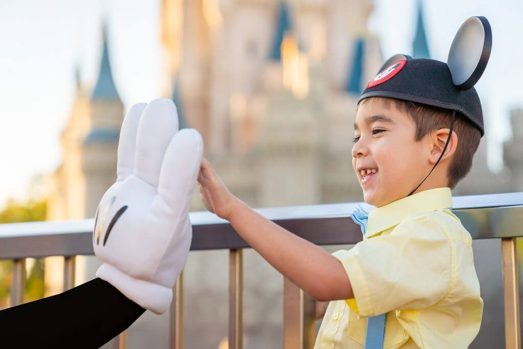 9 Disney World Photos That Will Make You Want to Bring Your Kids There featured by top US Disney blogger, Marcie and the Mouse: Anyone can high five Mickey Mouse while wearing a black shirt and a Mickey glove, especially outside Cinderella's Castle at Walt Disney World's Magic Kingdom for a Disney World photo shoot. #wdw #magickingdom #disneyphoto #wdwphotoshoot #disneyphotographer