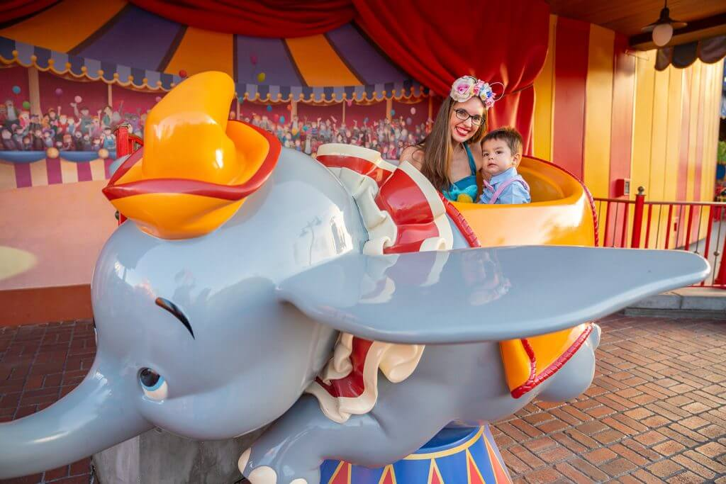 9 Disney World Photos That Will Make You Want to Bring Your Kids There featured by top US Disney blogger, Marcie and the Mouse: Next to Dumbo the Flying Elephant is a special Walt Disney World photo spot. It's a perfect Disney World photo spot for kids and families! #dumbo #magickingdom #wdw #waltdisneyworld
