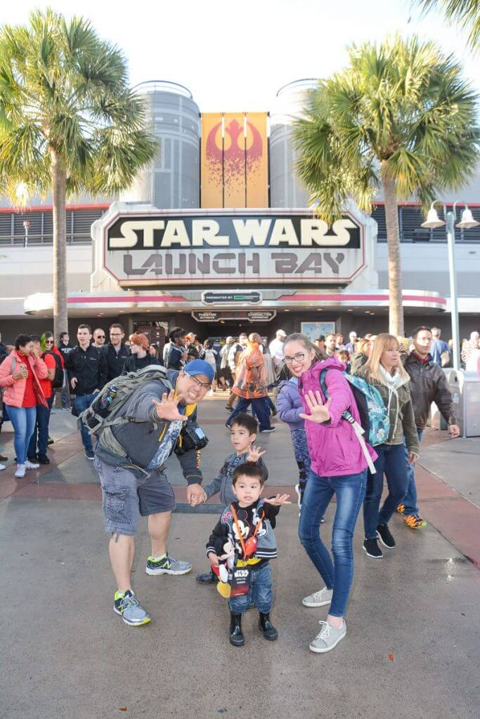 PhotoPass photographers are on hand to take family photos in front of Star Wars Launch Bay at Disney's Hollywood Studios.