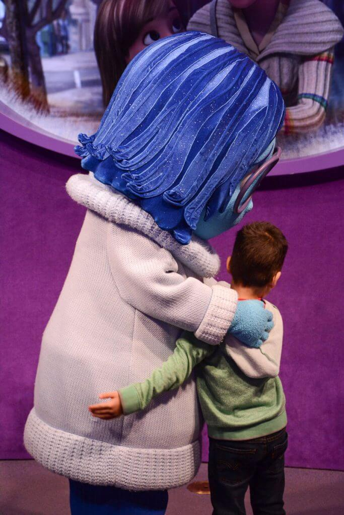 If you're going to Epcot with kids, you'll definitely want to stop by Pixar's Inside Out character meet and greet with Joy and Sadness. #insideout #pixar #epcot #sadness #waltdisneyworld #disneyworld